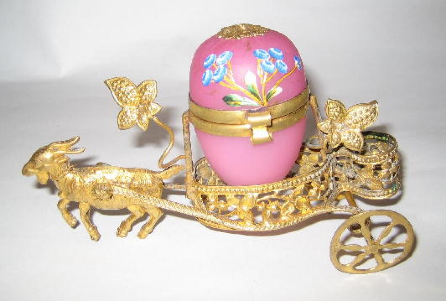 A Dinky Pink Opaline Glass Egg and Goat Cart
