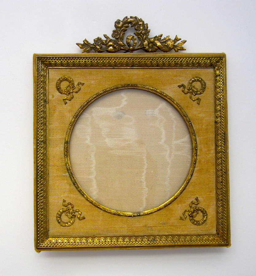 Antique Empire Dore Bronze Frame with Fine Classical Motifs.