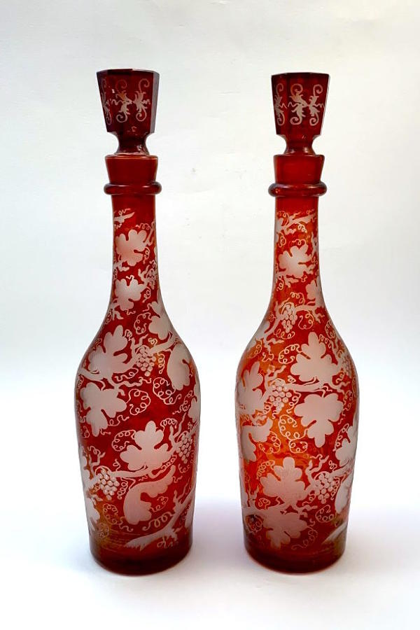 Pair of Antique Ruby Red Decanters Engraved with Vine Leaves