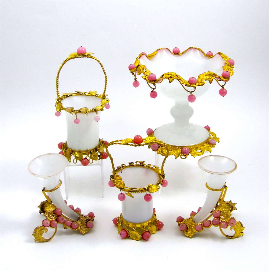 A Collection of White Opaline Glass Items with Pink Baubles